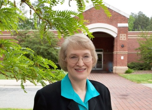 As part of her recognition as a Town Treasure, Alice's photograph was taken in front of the Southern Human Services Center in Chapel Hill
